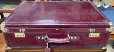 A Bugatti ox blood leather suitcase with brass corners