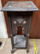 An Anglo Indian carved side table with a square top and arched sides with square legs