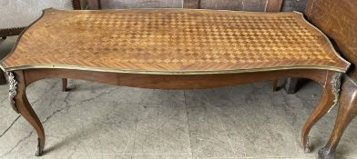 A French Kingwood coffee table with a shaped parquetry top on cabriole legs with gilt metal mounts