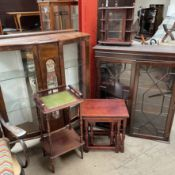 A 20th century walnut display cabinet together with a mahogany bookcase top, a nest of tables,