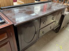 A 20th century mahogany sideboard with cupboards and drawers on cabriole legs