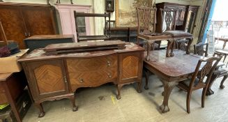 A mahogany extending dining table with pie crust edge on leaf carved cabriole legs and claw and