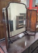 A walnut framed triptych dressing table mirror