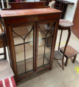 An Edwardian mahogany display cabinet together with a mahogany torchere and an oak table