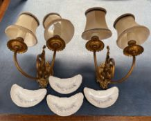 A pair of gilt metal twin branch wall lights together with a set of four continental porcelain