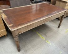 A Victorian walnut library table with an inset top on turned legs