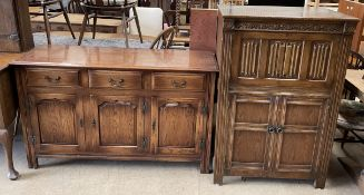 A 20th century oak sideboard with a rectangular top above three drawers and three cupboards on