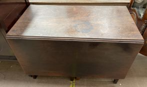 A 19th century mahogany gateleg dining table of rectangular form on square legs