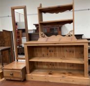 A pine bookcase together with a pine hanging shelves and a pine cheval mirror