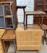 An oak chest of drawers together with a pine table,