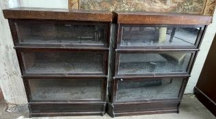 A pair of oak three section Globe-Wernicke sectional bookcases