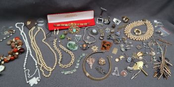 Assorted costume jewellery including a Christian Dior necklace, other necklaces, brooches, rings,
