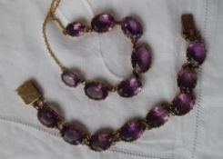 An amethyst set necklace, set with seven graduated oval faceted amethysts,