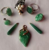 A jade pendant of pear shape,