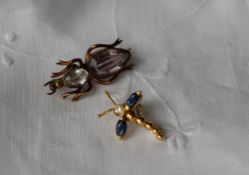 An 18ct yellow gold sapphire and diamond insect pendant set with two pointed oval sapphire wings