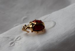An 18ct yellow gold, red and black enamel brooch in the form of a ladybird, 20mm long,