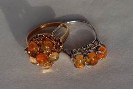 An orange opal dress ring set with six cabochon opals to a yellow metal setting marked 18k,