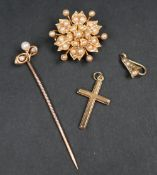 A 15ct yellow gold brooch of floral form, set with seed pearls,