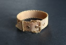 An 18ct gold bracelet in the form of a belt, of mesh form with a rope twist border,