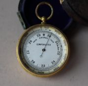 A yellow metal compensated pocket barometer, with a silvered dial,