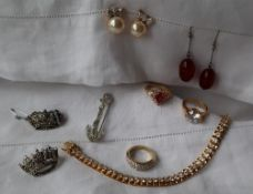 Assorted costume jewellery including a tennis bracelet,