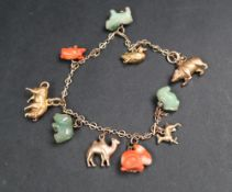 A Chinese yellow metal charm bracelet set with zodiac and other animals including a jade sheep's