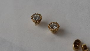 A pair of diamond stud earrings, the round brilliant cut diamonds each approximately 0.
