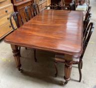 A Victorian mahogany extending dining table, with rounded corner,