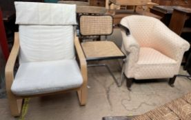 A 19th century horse shoe shaped elbow chair together with a modern chair and a bergere elbow chair