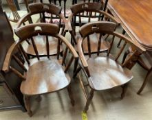 A set of four smokers bow elbow chairs,