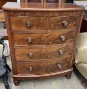 A Victorian mahogany chest the D shaped top above two short and three long graduated drawers on