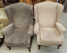 Two modern upholstered wing back elbow chairs,