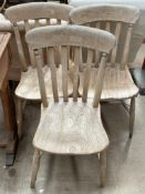 A set of three slat back kitchen dining chairs