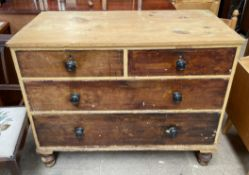 A Victorian pine chest with a rectangular top above two short and two long drawers on turned feet
