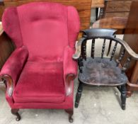 A smokers bow elbow chair with a spindle back and solid seat on turned legs together with an