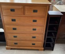 A reproduction satin walnut chest,