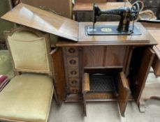 A Singer treadle sewing machine, with rise and fall action,