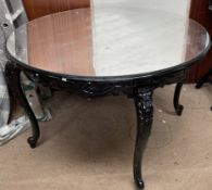 A Black painted shop display table with a mirrored top together with three make up artists