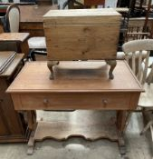 A mahogany desk with a rectangular top and a faux drawers on lyre supports,