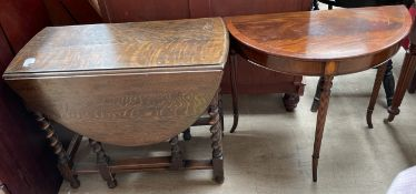 A 20th century oak gateleg dining table together with a mahogany half round table on reeded legs