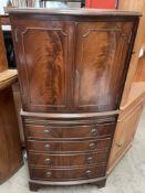 A 20th century mahogany drinks cabinet,