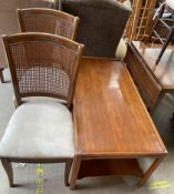 A reproduction yew coffee table together with a pair of modern bergere dining chairs