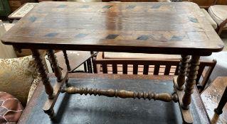 An Edwardian walnut side table,
