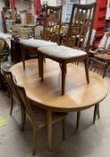A G-Plan teak extending dining table and six chairs