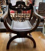 A carved Italian X frame chair,