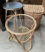 A wicker laundry basket together with a circular side table and a circular coffee table