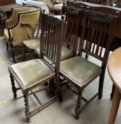 An Edwardian mahogany elbow chair together with a set of three oak dining chairs and an Ercol elbow