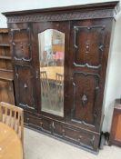 A 20th century oak wardrobe,