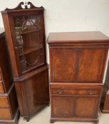 A 20th century mahogany standing corner cupboard together with a mahogany drinks cabinet