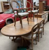 A modern pine extending dining table together with eight balloon back dining chairs a sideboard and